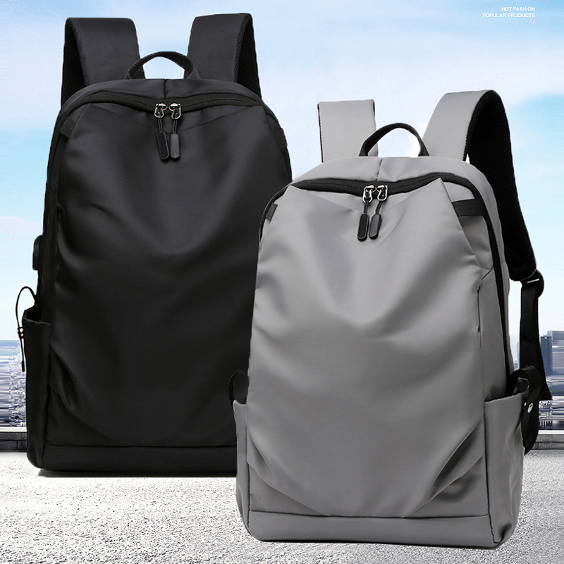 New nylon waterproof Solid Color Japanese and Korean mens backpack simple casual versatile fashion mens computer business Backpack
