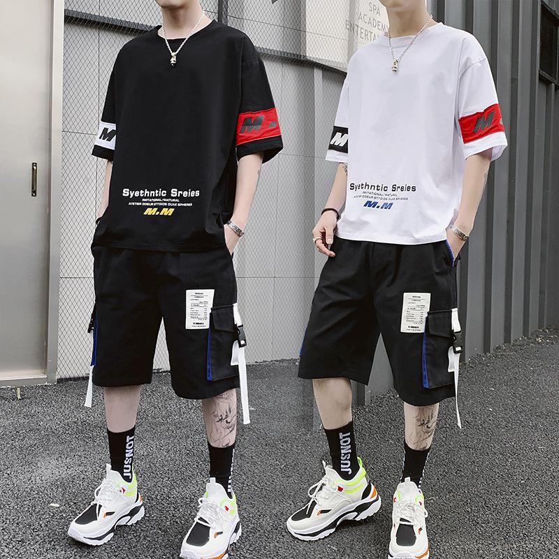 夏季运动套装男士休闲装帕耐克丝绸学生短袖t恤宽松短裤两件套图片