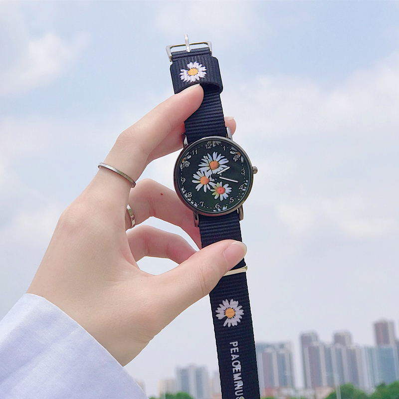 Small daisy watch female ins Fengsen department college wind junior high school students canvas Korean version simple and versatile small fresh