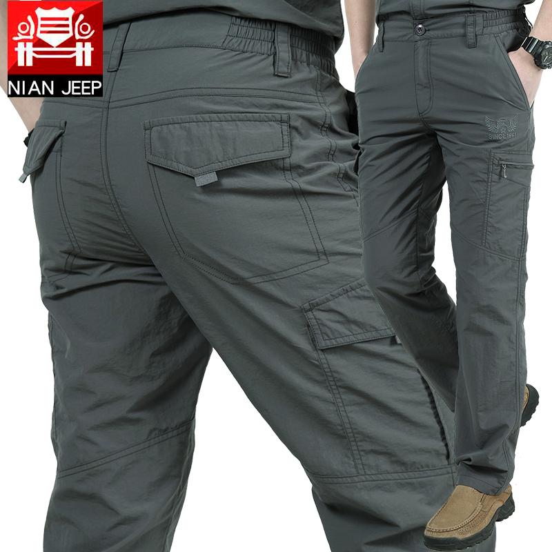 Весенние и летние быстросохнущие брюки мужской Более рыхлый с карманами Открытые спортивные брюки мужской водонепроницаемый Чрезвычайные брюки тонкие стиль брюки