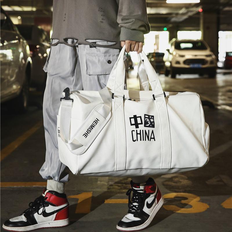 行李包女短途手提大容量衣服收纳袋子男网红防水皮质运动健身背包
