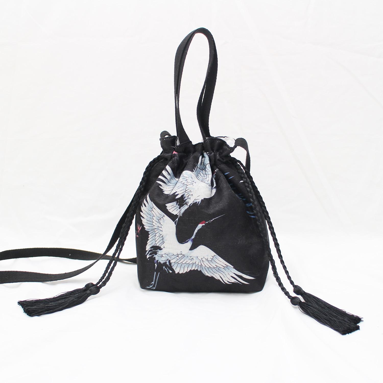 Original self-made Japanese and wind crane design tassel drawstring pocket dual-purpose messenger bag portable small bag
