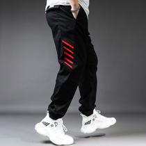 韩版加大码校园男青年运动裤胖人条纹织带拼接小脚裤卫裤18-35岁