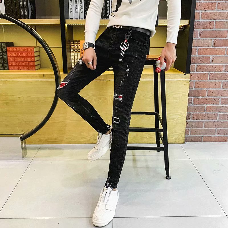 Fall / winter 2019 mens perforated embroidered printed jeans mens trend of slim and small foot elastic casual pants