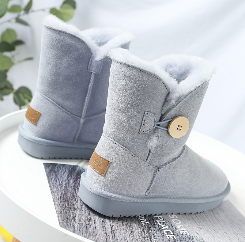 Snow boots womens 2020 new button fur integrated middle tube boots flat bottom thickened warm thick soled wool cotton shoes