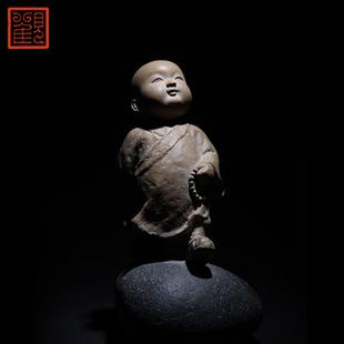 台湾铁丸石收藏工艺佳品观复博物馆林昭发纯真小沙弥石雕摆件