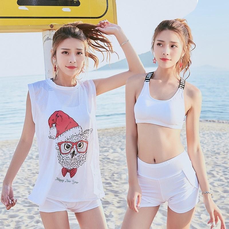 12月02日最新优惠分体泳衣女韩版运动式保守罩衫三件套卡通印花平角沙滩比基尼泳装