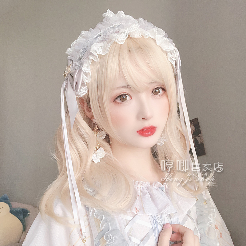 2020 new product Qi Banghai wig female milk golden wave short curly double horsetail Lolita hair package