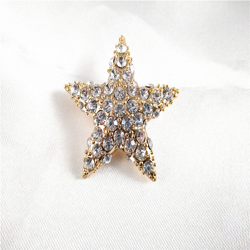 Temperament star Brooch geometric gold inlaid with more than 40 glass diamonds, fashionable daily clothing collocation has a heavy feeling