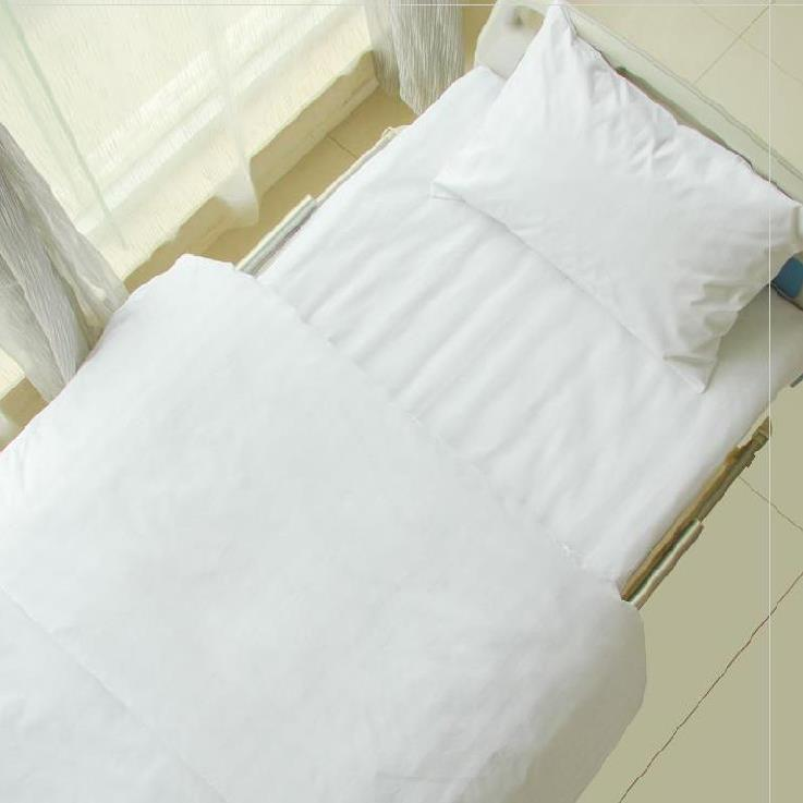 Pure cotton sanitary room of Japanese medical hospital. Three piece bedspread and dense bedding health care hospital