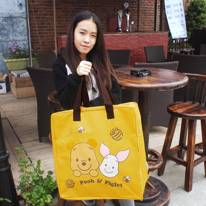 Cartoon cute super large capacity one shoulder portable Pooh Winnie waterproof canvas travel bag quilt storage bag woman