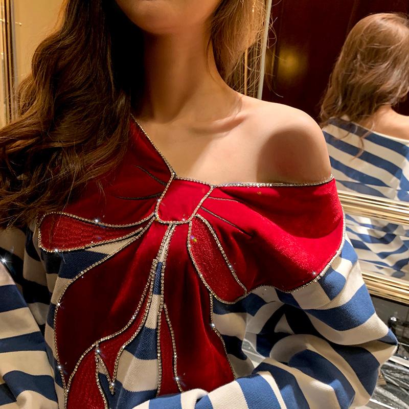【地球店】蓝白条纹丝绒蝴蝶结宽松bf慵懒风网红露肩卫衣女秋薄款