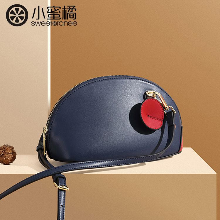 【小蜜橘】バッグが可愛いミッキーマウスの貝殻バッグがショルダーバッグの上品な質感です。