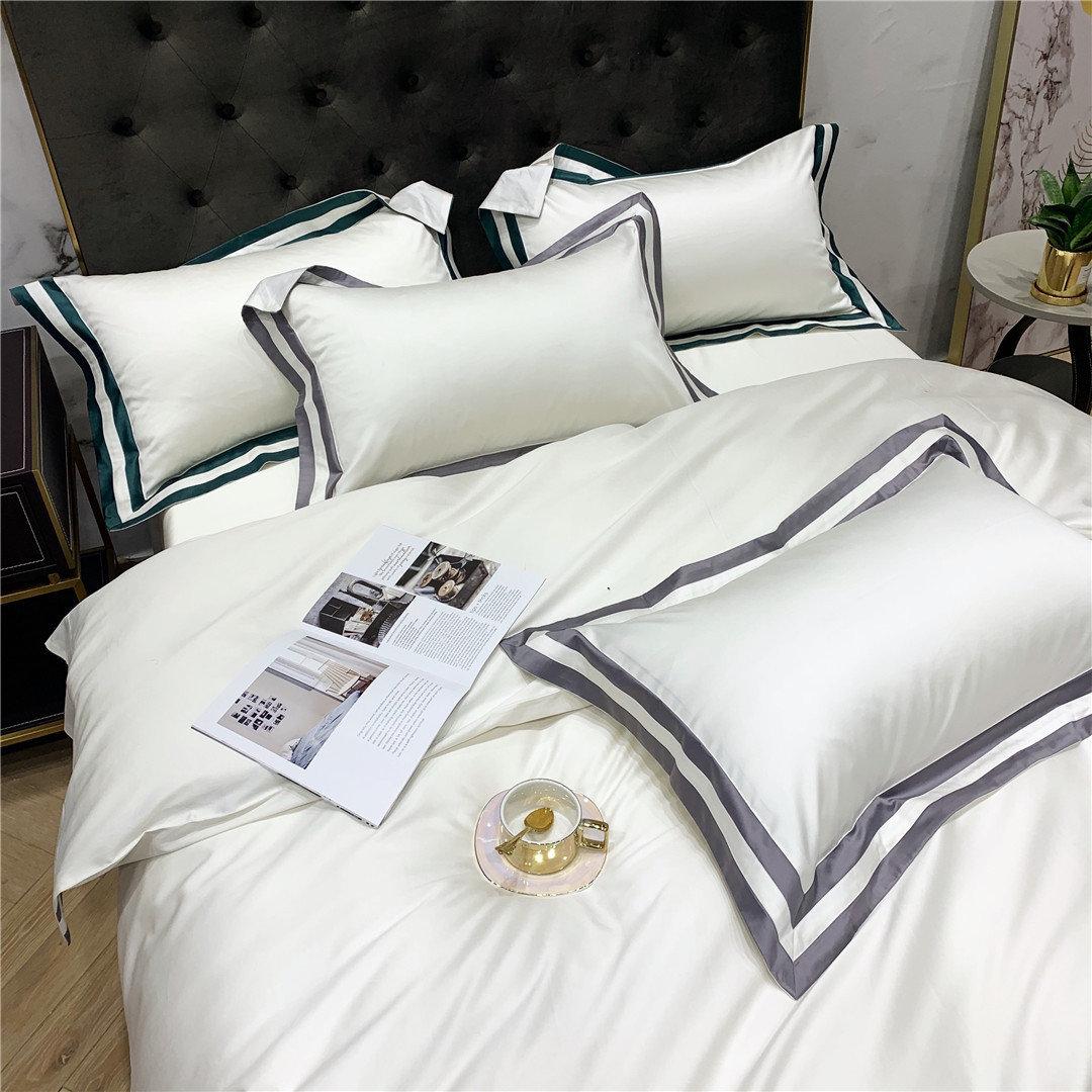 イタリア式の軽い贅沢な貴族の白いハイエンドの寝具の寝具の寝具の上の用品の御用の100本の純綿の長い綿糸の4件のセットの家庭用紡績
