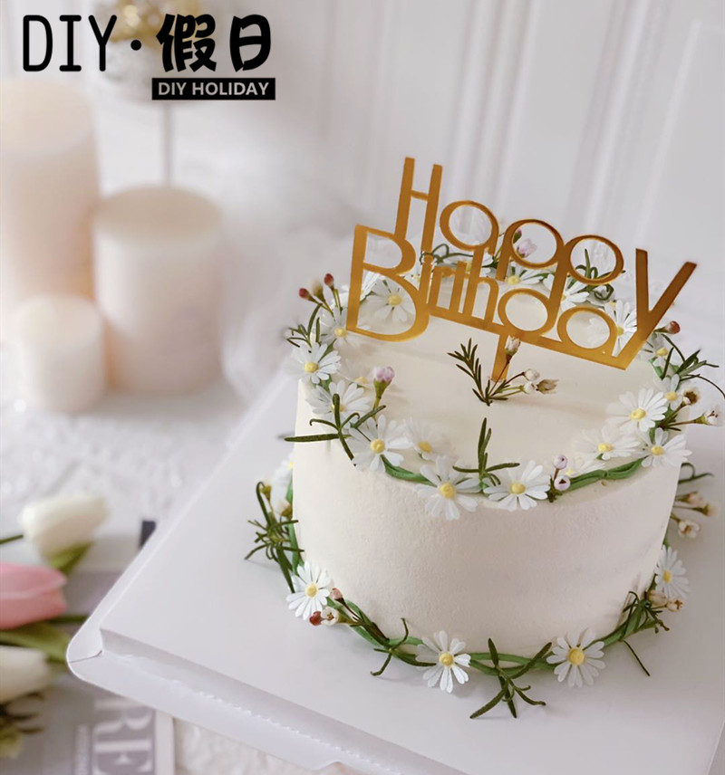 Classic simple birthday cake decorated with gold and silver happy birthday