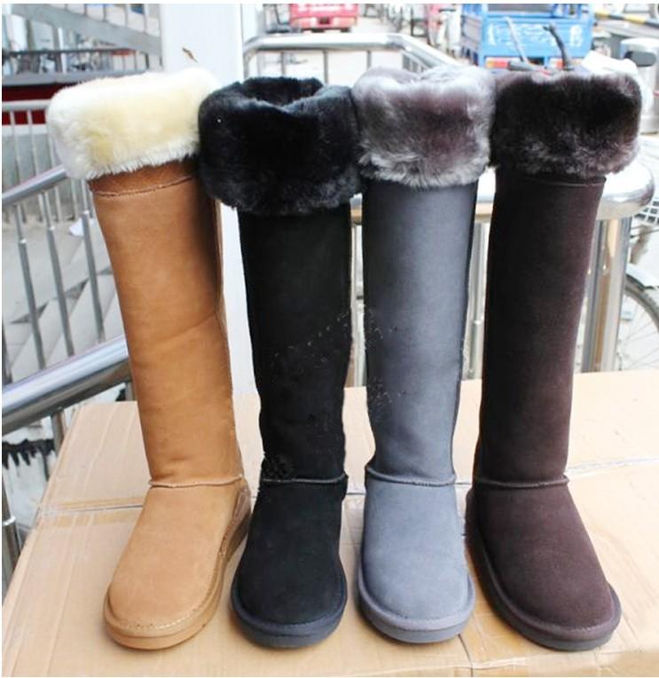 毎日の特価の新型の長靴の防水の本革のひざを越す雪の靴の超高筒の美脚の著しいやせている保温の靴