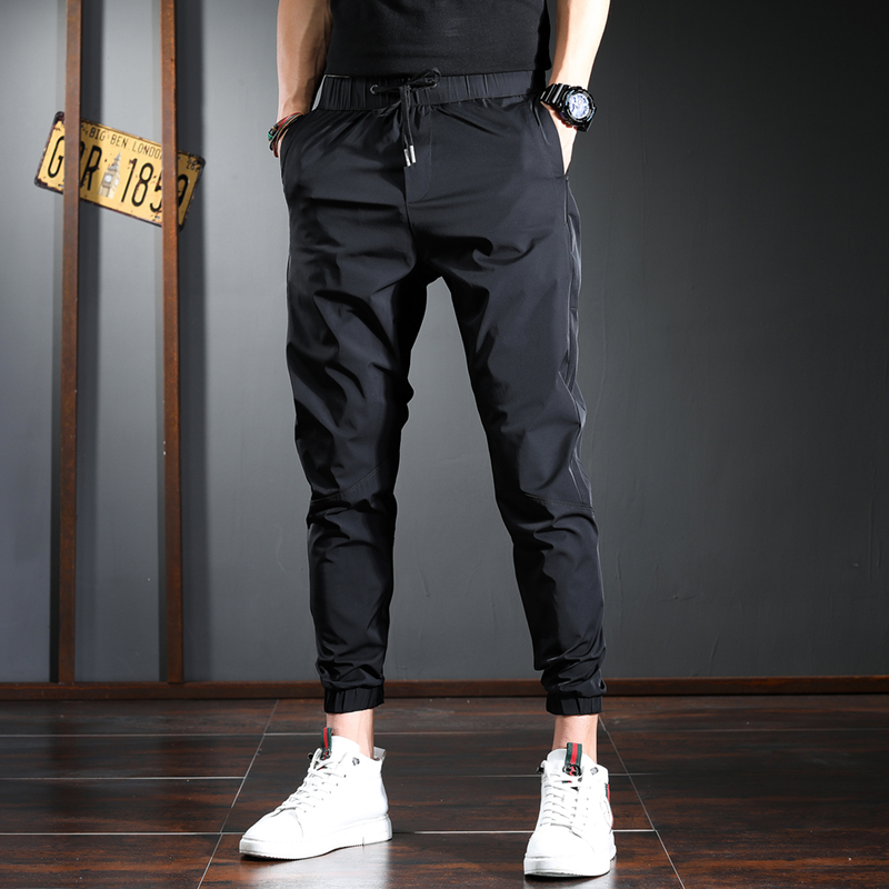 Trendy brand casual pants men's elastic waist Slim fit feet trend all-match men's trousers spring and summer ice silk thin pants