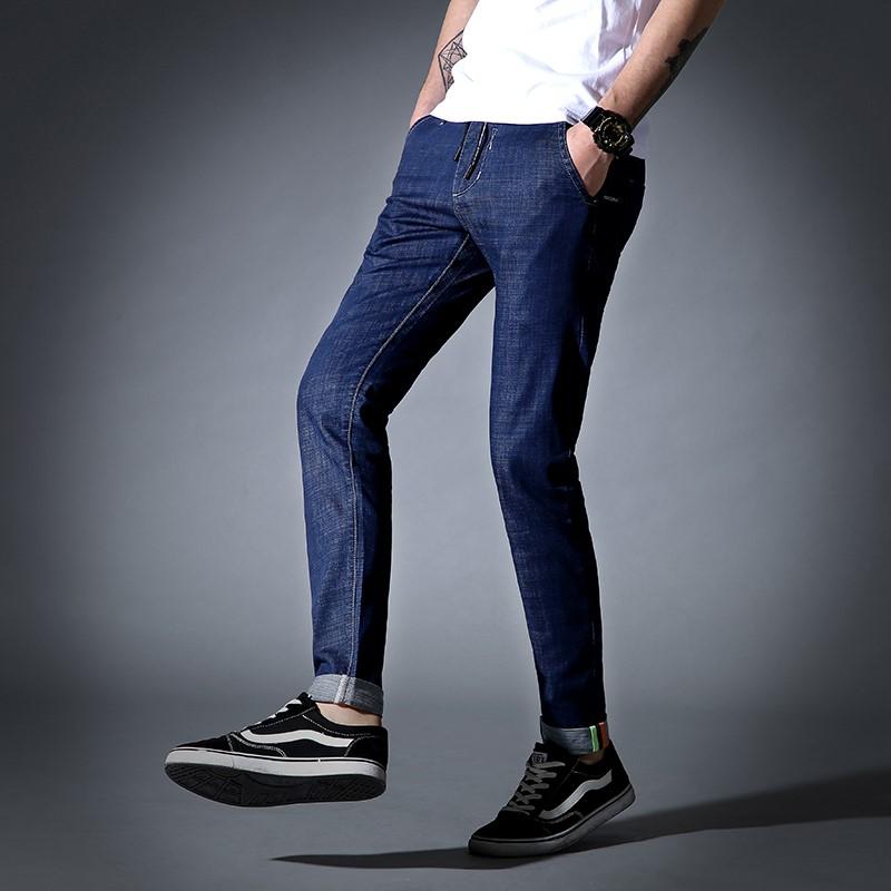 男子裤子薄款男士裤子薄牛仔布韩版水洗男装拉链长裤微弹牛仔裤。