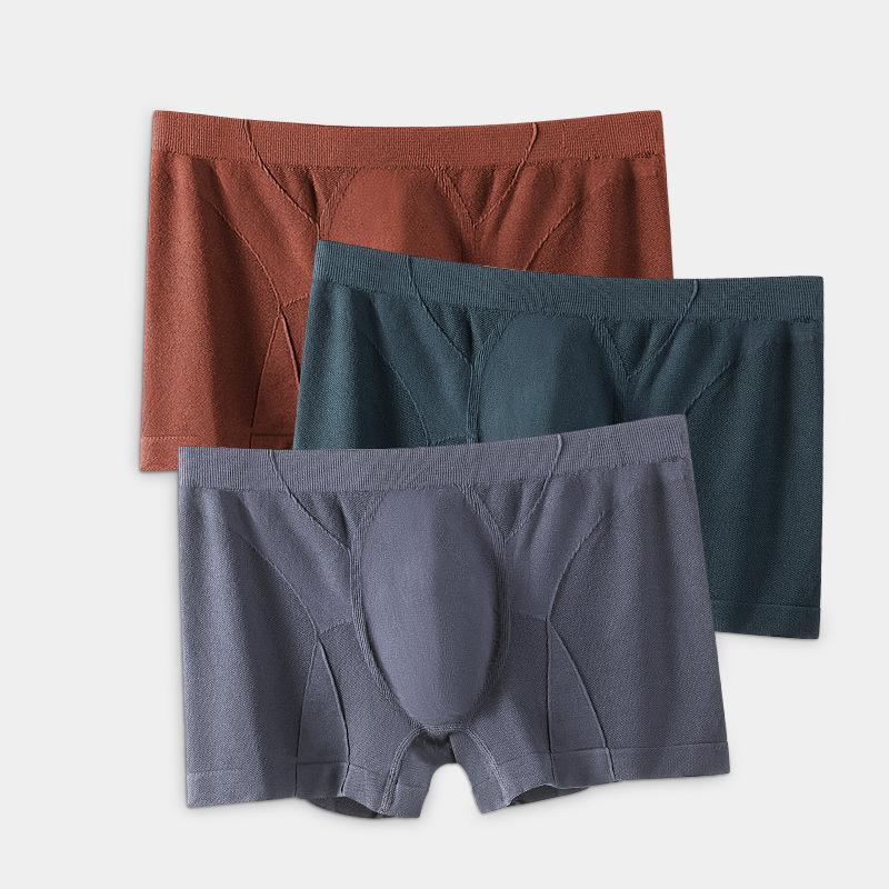 トレンドメンズシームレスパンツコットン股間パンツゆったり中腰ヒップ通気性のある四角いショートパンツ。