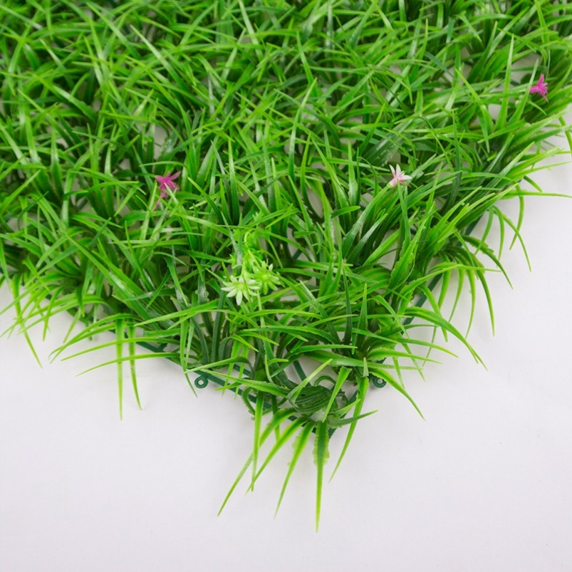 Artificial plastic wall decoration of lawn with flowers and turf