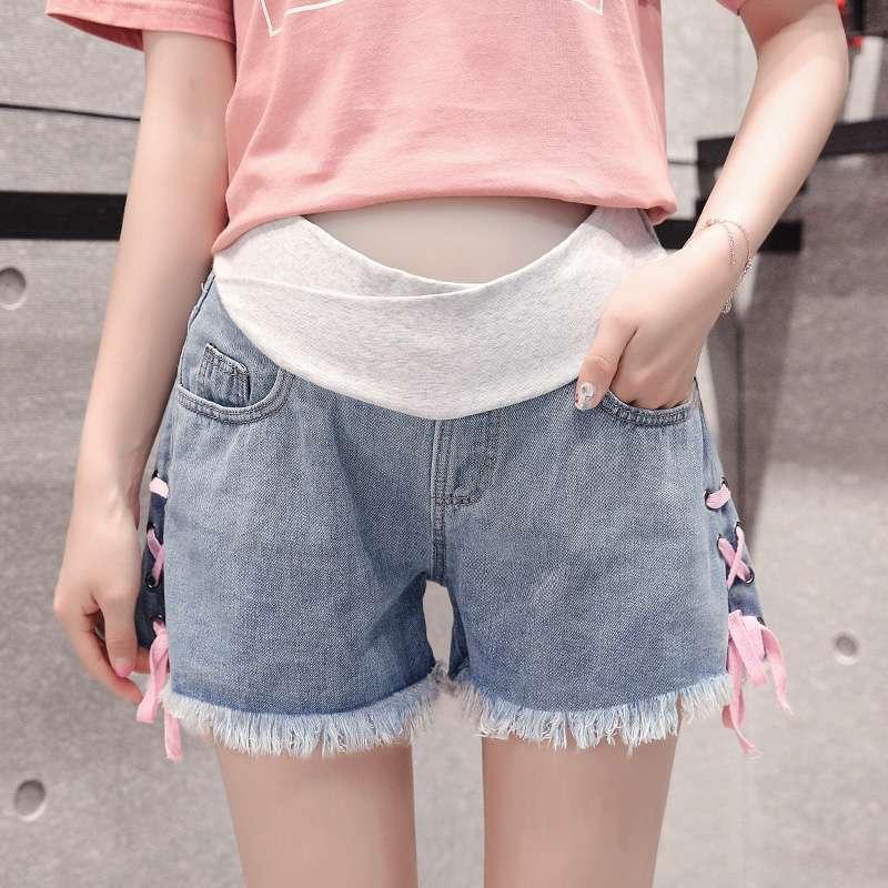 妊婦のデニムのショートパンツの女性の夏のスタイル2019新型ファッションの腰が低い外は春秋の薄いタイプを着てズボンの夏の服を打ちます。