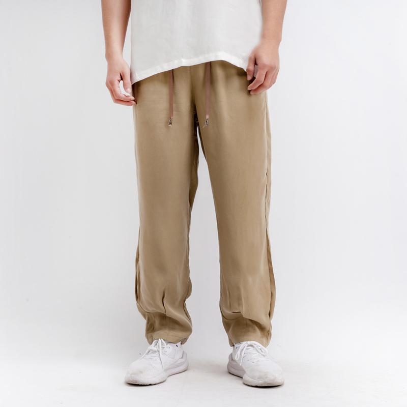 Summer light and thin mens casual pants silk silk silk elastic tight hemmed overalls mens copper ammonia Harun pants