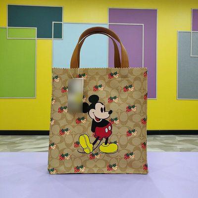 新商品の簡単なミッキーのショッピングバッグの補習手提げ袋とカジュアルランチタイムはネズミの学生を包んで本のハンドバックの女性の夏を持ちます。