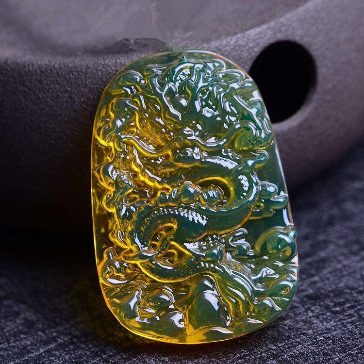 天然墨西哥蓝珀龙牌挂坠琥珀原石如日中天雕件吊坠男女毛衣链