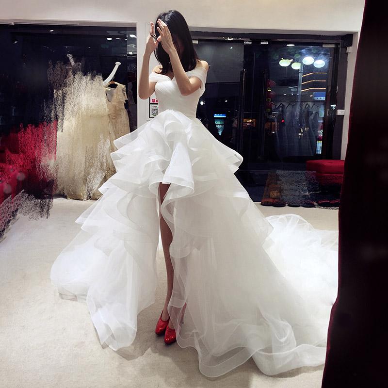婚纱2018新款新娘一字肩拖尾公主梦幻前短后长短款旅拍轻婚纱赫本