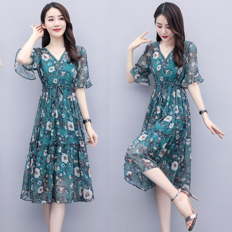 Two piece chiffon dress with suspender and medium length floral skirt
