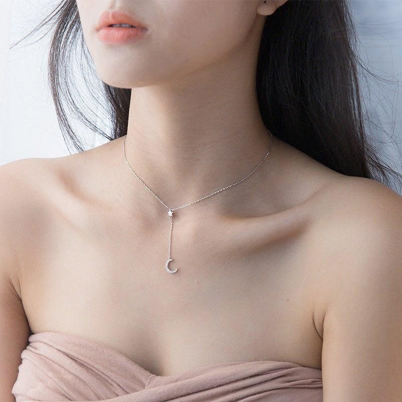 Korean version versatile Diamond Star Moon Tassel Necklace womens style shows clavicle temperament star moon lock Sterling Silver bone chain