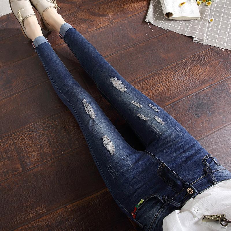 欧熙妮2018春季韩版新品小脚刺绣牛仔裤女修身显瘦破洞九分铅笔裤