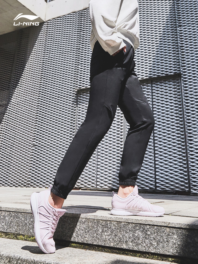 Li Ning sweatpants women's new women casually accept small-footed trousers woven pants sweatpants.