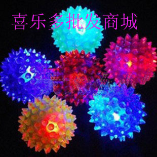 Elastic massage ball with a whistle 6 5CM hedgehog ball flash luminous ball of barbed ball stall toy wholesale