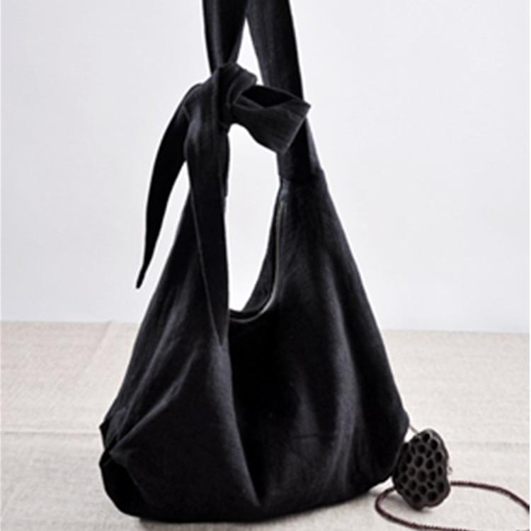 オリジナルのデザインは斜めにクロスして布のバッグの例外的な風格の文芸の森の女性范の純色の綿の麻の女性のバッグの単に肩が箱の規格品を包むことを包みます