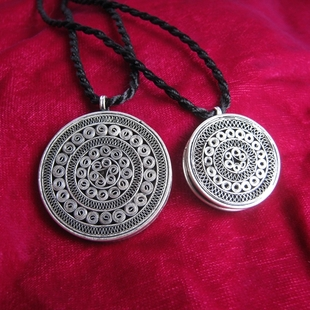 Full 88 Free Dongzhai handmade Miao Miao village silver pendant necklace men and women knitting yarn sun drum necklace