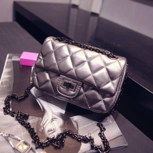 Ultra Q! The new 2015 European and American fashion aslant female BaoLing madame chain bag one shoulder of his small bag