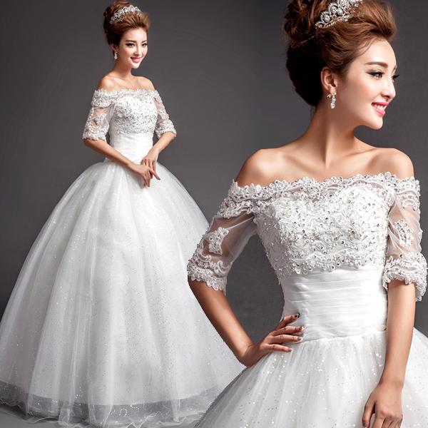 Свадебное платье, расшитое пайетками с открытыми плечами и пышной многослойной юбкой