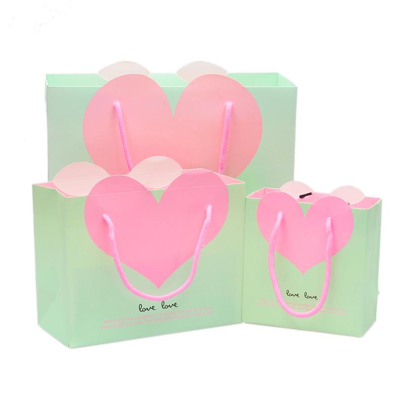 包邮包装袋结婚回礼手提纸袋礼品袋爱心袋婚庆礼品袋批发创意纸袋