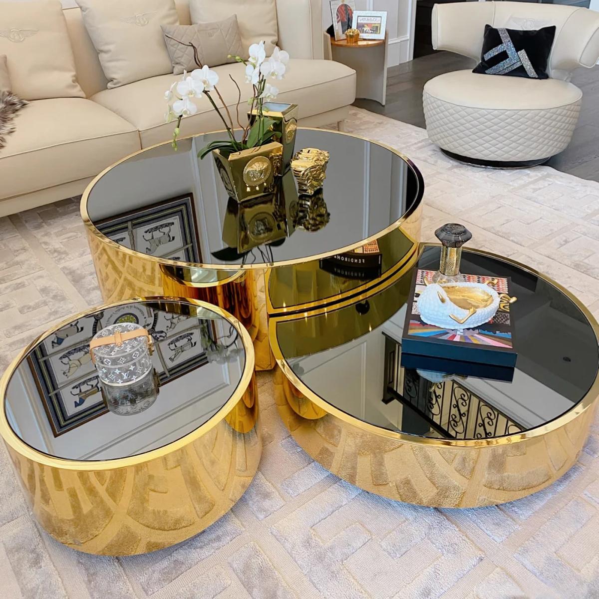 北欧は簡単で現代茶の何ソファーの客間のガラスのお茶台の簡単な家具は軽奢で贅沢な小型住宅型の円形の小さいテーブルです。