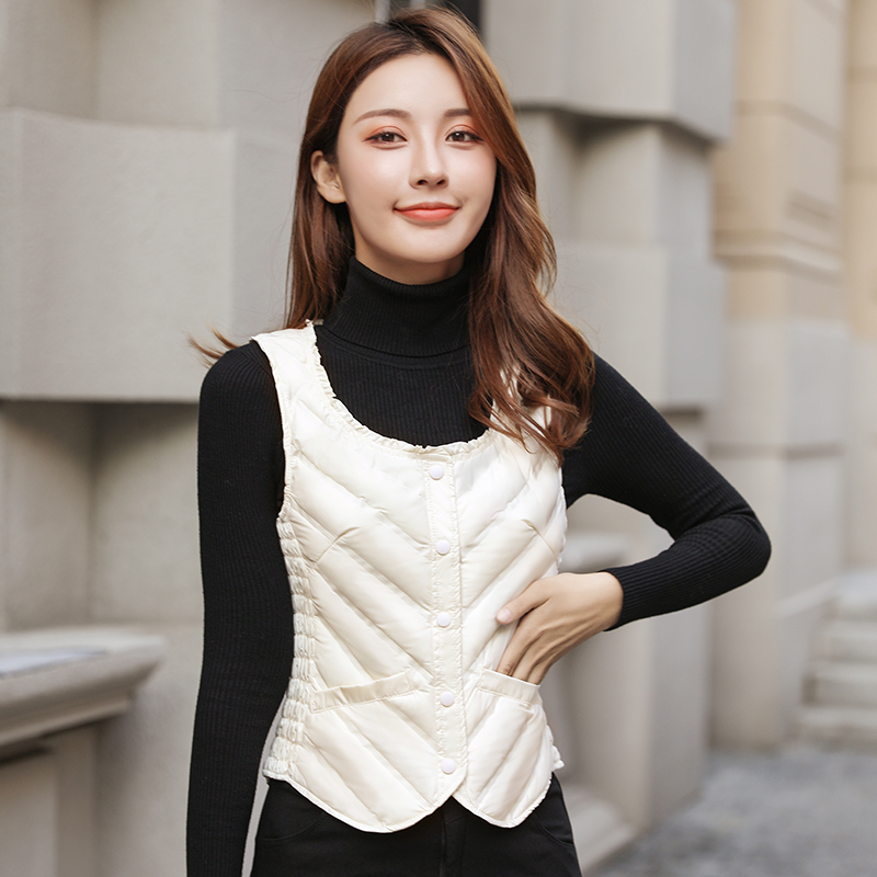 Womens short down waistcoat, slim fit, Korean version, on the shoulder, wearing a light and close fitting waistcoat, down jacket, inner liner, warm vest