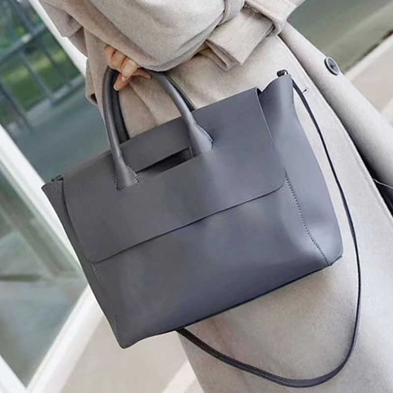 Leather womens bag 2021 autumn and winter new high-capacity soft leather hand-held Single Shoulder Messenger Bag high sense commuter womens bag