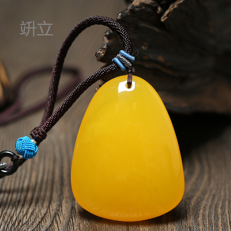 Transfer the second generation of imitation amber honey wax Wu Shi brand Water Drop Pendant chicken oil yellow coat chain necklace female Pendant Jewelry