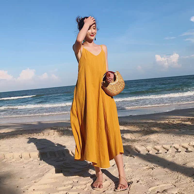 zwmh旅行路上沙滩裙海边度假连衣裙波西米亚黄色吊带长裙女夏露背