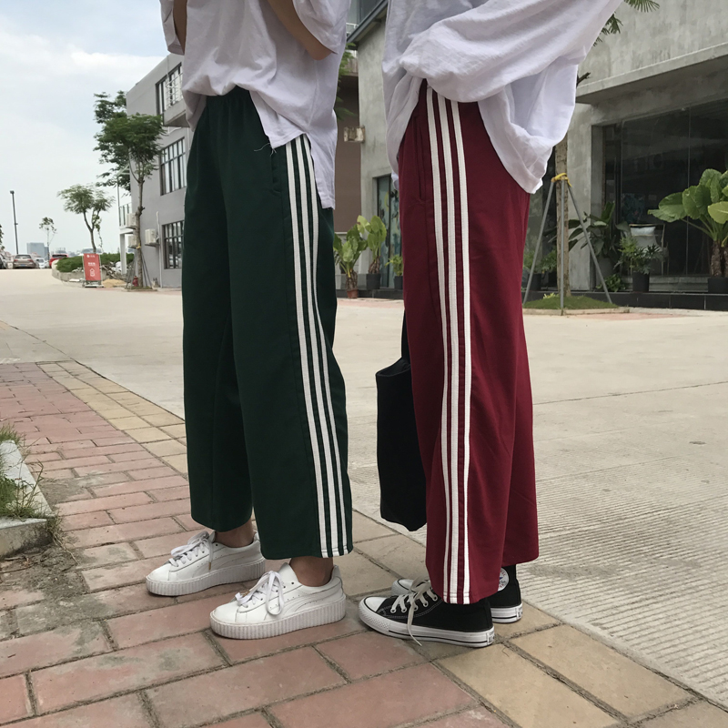 Three bar sports pants mens and womens leisure pants school uniform pants Korean Trend straight tube stripe nine point wide leg pants autumn