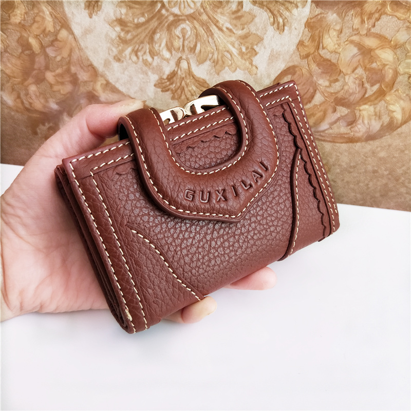 Pure leather three fold short wallet womens Leather Multi functional folding large capacity leather wallet wallet bag Korean version