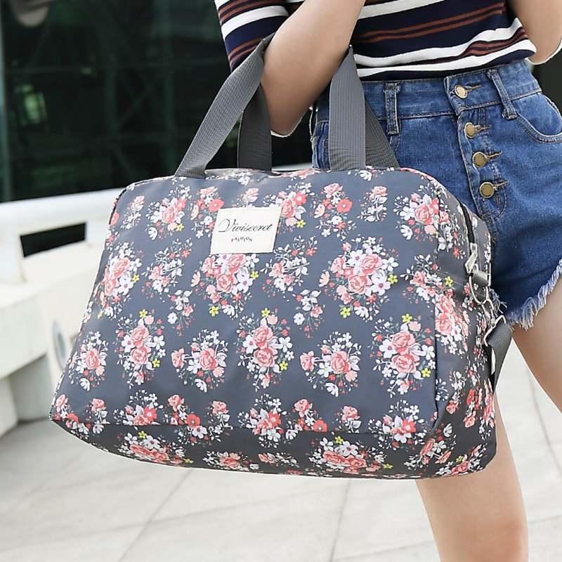 短途旅行包女手提韩版碎花大容量行李袋折叠防水旅游包运动健身包