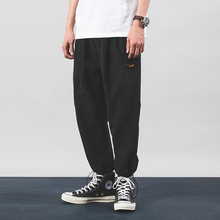A long American retro-labeled casual pants with loose nine-minute trousers and adjustable casual pants