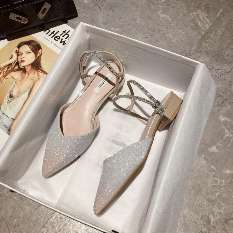 。 Slotted Rhinestone sandals womens 2021 new summer high heels versatile fashion pointed middle thick heel flat bottom
