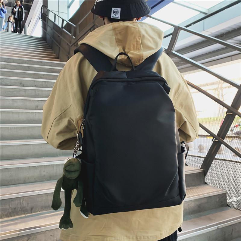 日系简约休闲帆布书包男时尚潮流街头高中大学生双肩包背包女韩版